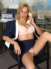 Skirt wearing blonde quickly undresses by the desk